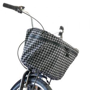Reflekterande regnskydd till cykelkorg